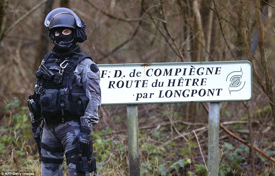 A member of the French National Police Intervention Group is  near Villers-Cotterets where the suspects are believed to have fled on foot