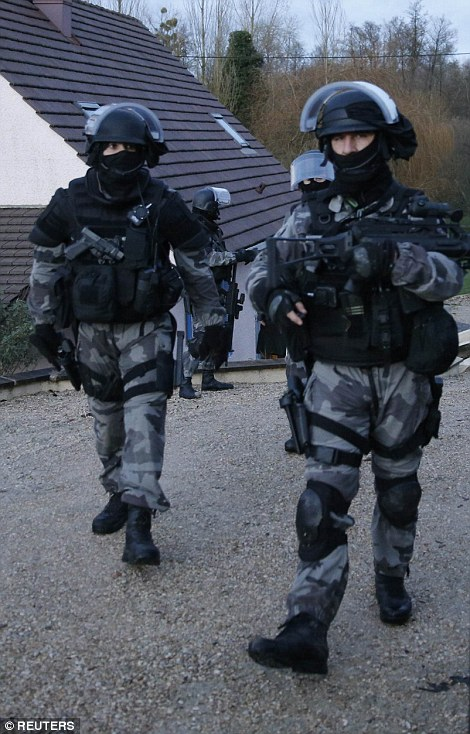 French anti-terrorism police converged on an area northeast of Paris on Thursday